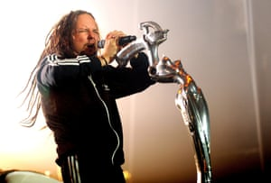 Jonathan Davis of Korn performs with a microphone stand designed by HR Giger.