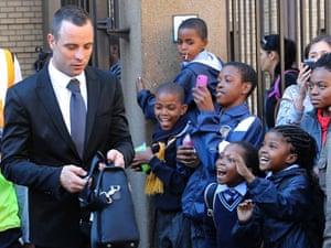 Oscar Pistorius leaves the high court in Pretoria on Monday.