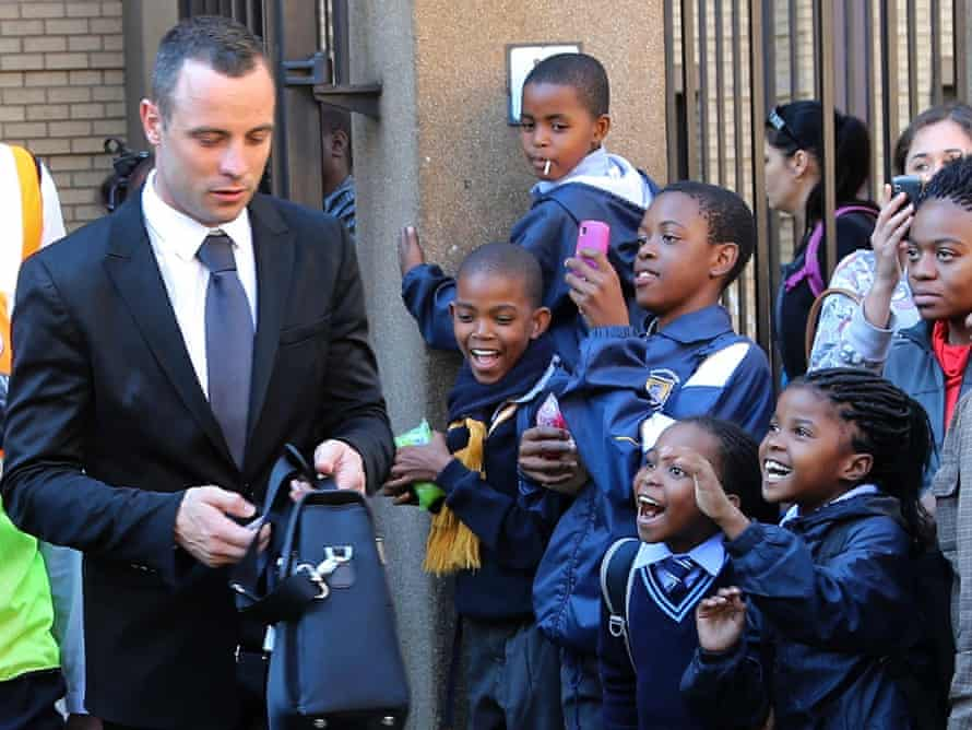 Oscar Pistorius leaves the high court in Pretoria on Monday.