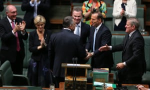 The Treasurer Joe Hockey is congratulated by his front bench colleagues after delivering his first budget in The House of Representatives tonight, Tuesday 13th May 2014.