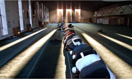 Men pray in Glasgow mosque which was one of two targeted in the city by Britain First