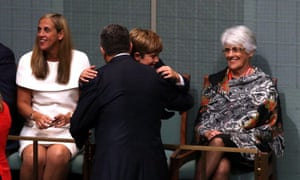 The Treasurer Joe Hockey gets a hug from his son Xavier watched by his wife Melissa Babbage (left) after delivering his first budget in the House of Representatives tonight, Tuesday 13th May 2014.