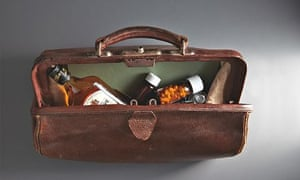 An open doctor's bag with whisky and drugs inside