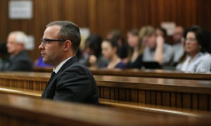 Oscar Pistorius listens to the state prosecutor Gerrie Nel during his trial on Tuesday.