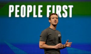 Mark Zuckerberg, microphone in hand, addresses a conference