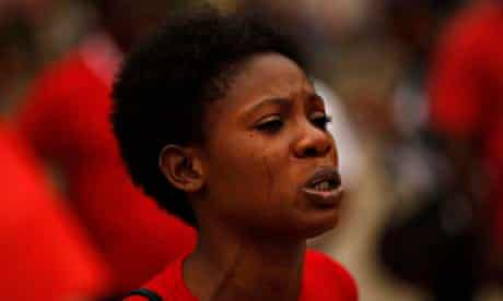 A Nigerian woman cries as she takes part in an anti-Boko Haram protest in Malaga