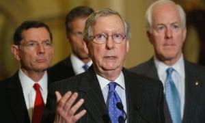 US Senate Minority Leader Mitch McConnell, centre.