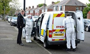 Police and forensics officers outside a house in North Shields