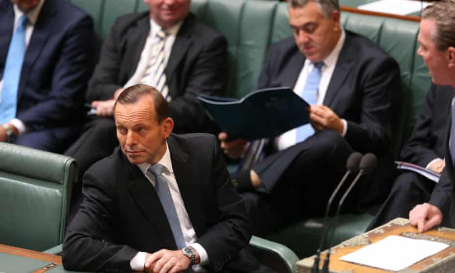 Tony Abbott listens during question time on Wednesday.