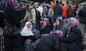 Family members wait outside a coal mine in Soma, western Turkey.