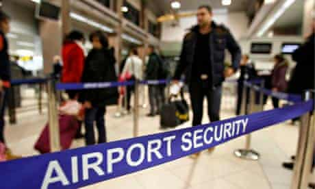 Romanians pass through airport security for a flight to Heathrow airport in Britain