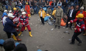 Rescue workers carry a rescued miner from the mine in Soma, western Turkey.