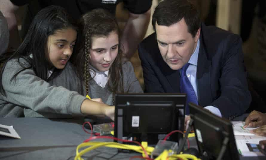 two girls show George Osborne code on a computer