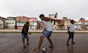 Children play football in the Manguinhos slums in Rio de Janeiro