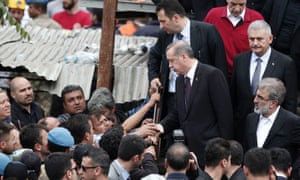 Turkey's Prime Minister Tayyip Erdogan (talks with relatives of miners who were killed or injured in a mine explosion, during his visit to Soma.