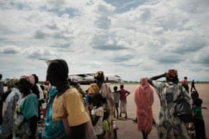 People waiting at the airstrip in Malakal.