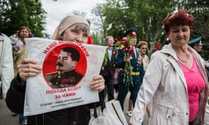 A woman carries a protrait of Stalin during Victory day celebrations in Odessa.