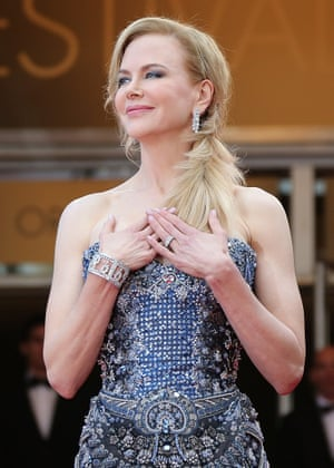 """Australian actress Nicole Kidman poses as she arrives for the Opening Ceremony and the screening of her film """"Grace of Monaco"""" at the 67th edition of the Cannes Film Festival"""