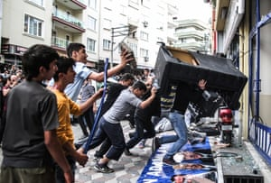 People attack the Soma offices of Prime Minister Recep Tayyip Erdogan's Justice and Development Party during his visit to the coal mine in Soma, Turkey, Wednesday, May 14, 2014.