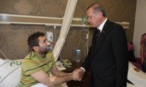 MANISA, TURKEY - MAY 14 :  Turkish Prime Minister Recep Tayyip Erdogan (R) visits injured miners at Akhisar Hospital in Manisa, Turkey on May 14, 2014.