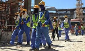 Foreign laborers work in Qatar
