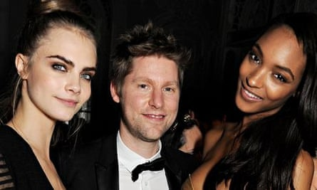 Christopher Bailey with models Cara Delevingne and Jourdan Dunn