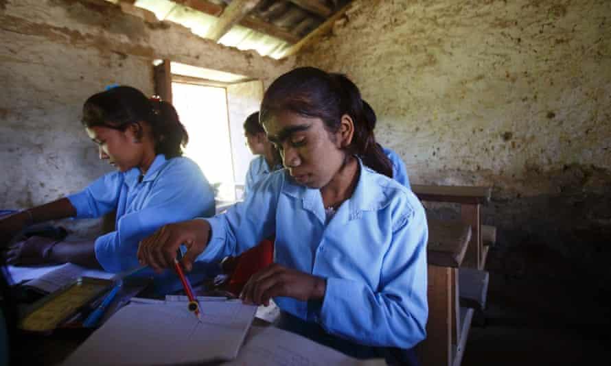 Manjura Budhathoki, 14, studies inside a classroom at a school in Kharay, northeast of Kathmandu.