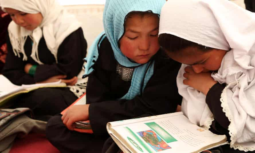 Afghan children attend their class at a school in Bamyan province, central Afghanistan.