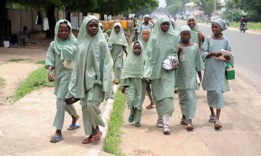 School girls walk home after school hours in Maiduguri, capital of Borno State.