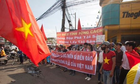 Workers hold banners reading 'Please protest in the right way' and 'We are looking at soldiers on islands, and the Paracels and the Spratlys belong to Vietnam' during a protest in an industrial zone in Binh Duong province, Vietnam.