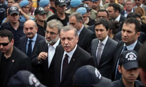 Turkey's Prime Minister Recep Tayyip Erdogan, center, next to his adviser Yusuf Yerkel (right) who was photographed kicking a protester.