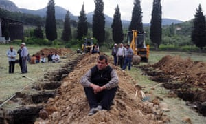 Rows of newly dug graves for the mine accident victims in Soma.