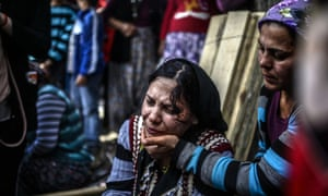 A woman cries during a funeral ceremony for miners who died in the Soma explosion.