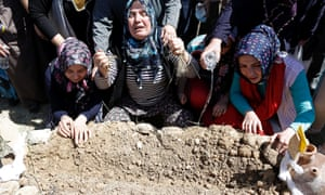 People mourn during the funerals for the miners victims of a mine explosion near Soma, Manisa province, Turkey,
