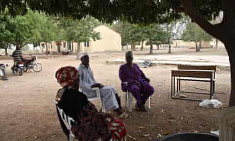 Yerima Pudza, Asabe Kwambura and Bulama Modu sit under a tree
