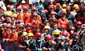 Miners and rescue workers outside the mine in Soma, Turkey
