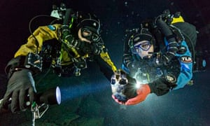 Divers with the 12,000-year-old skull of a girl