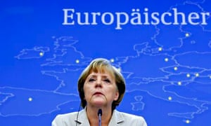 German Chancellor Merkel holds a news conference during the EU leaders summit in Brussels