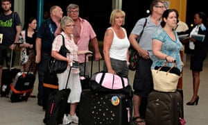 British tourists queue to check in at Moi International Airport in Mombasa