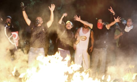 A fire is set in the street as demonstrators in São Paulo rally against the hosting of the World Cup