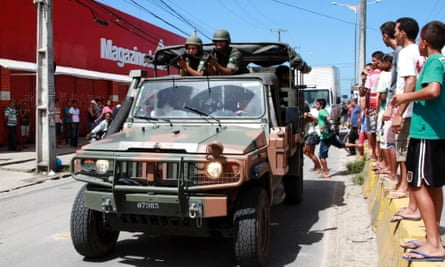Army soldiers patrol a street during a police strike in Recife