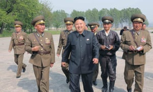 Kim Jong-un with officials during an inspection of the Korean People's Army (KPA) airforce.