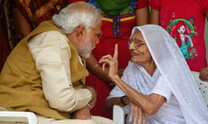 Opposition leader and India's next prime minister Narendra Modi listens to his 90-year-old mother Hiraben during a visit to seek her blessings.