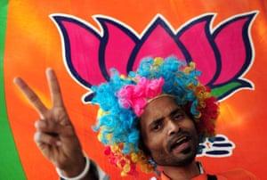 A supporter of the Bharatiya Janata Party (BJP) celebrates in Bangalore, India.