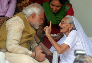 BJP prime ministerial candidate Narendra Modi listens to advice from his mother Hira Ba at her home in Gandhinagar, near Ahmedabad, as the results are announced.