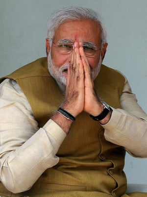 Modi then greets the press and supporters at his mother's home.