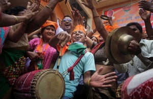 Joy in unconfined as BJP supporters celebrate the party's winning preliminary result outside their office in Gauhati, India.