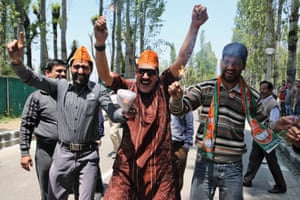 BJP supporters celebrate preliminary results that showed their party winning by a landslide, in Srinagar, India.