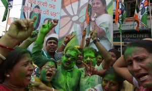 Indian supporters of Trinamool Congress (TMC) celebrate the party election results near the house of party supremo and chief minister of eastern West Bengal state,  Mamata Banerjee in Kolkata.