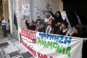 Finance ministry's cleaning staff shout slogans outside the Finance Ministry, in Athens, Greece, 07 May 2014.